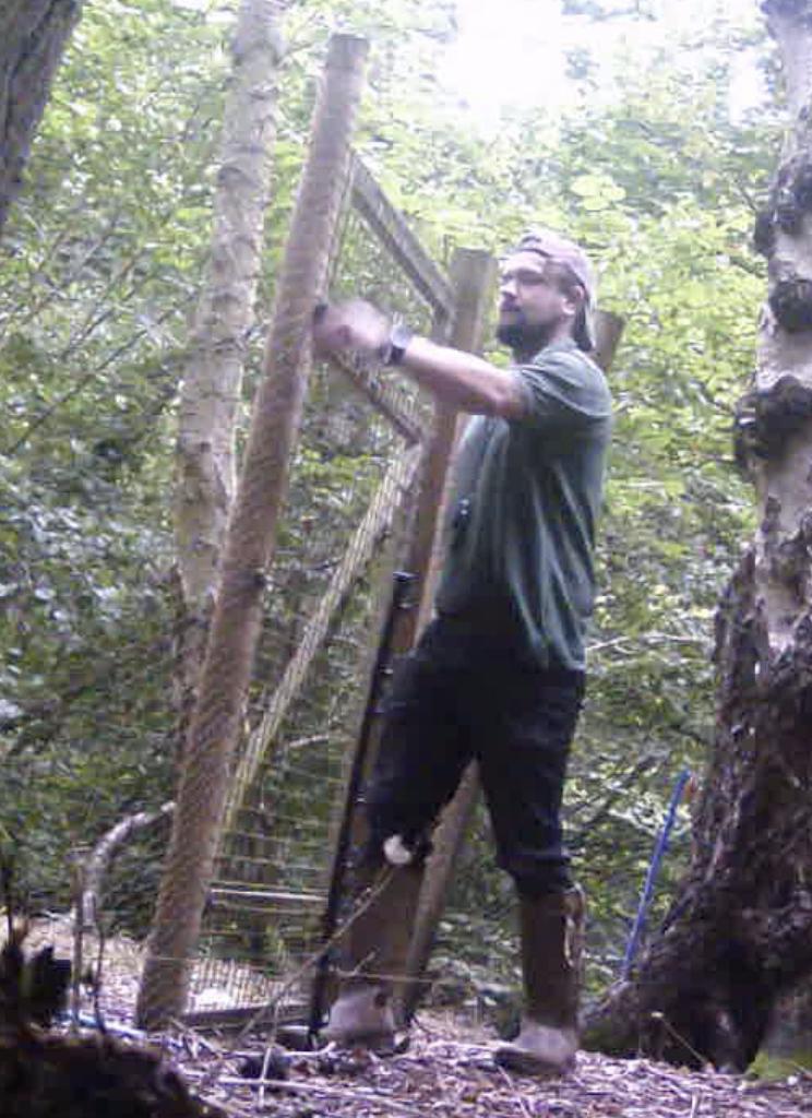 gamekeeper checking traps